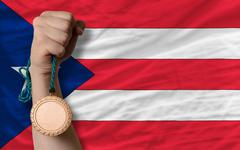 Bronze medal for sport and  national flag of puertorico Stock Photos
