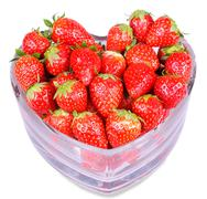 Heart shaped glass with red strawberries isolated Stock Photos