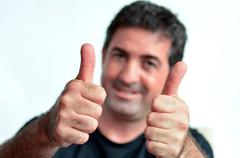 Happy young mature man showing thumbs up Stock Photos