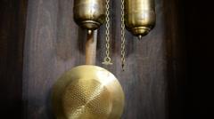 Kettlebell old pendulum clock Stock Footage