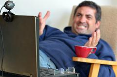 man working or learning from home - stock photo