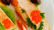 Stock Video Footage of salmon chunks and caviar on baguette