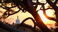 Stock Video Footage of Beihai Stupa with Sunset, taken from Jinshang Park, Beijing, China.