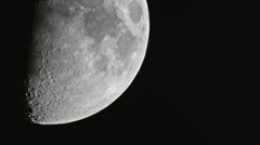 Half moon crossing showing off craters 4K Stock Footage