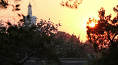 Beihai Stupa with Sunset, taken from Jinshang Park, Beijing, China. Stock Footage