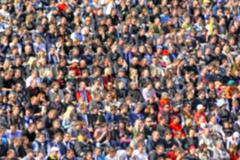 Stock Photo of blurred crowd of spectators on a stadium tribune at a sporting event