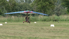 Motorized hang glider taking off Stock Footage