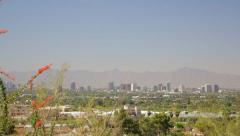 Downtown Phoenix and Sierra Estrella mountains - stock footage