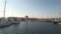 Boat entering in Rogoznica marina Stock Footage