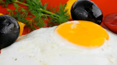 Fried egg served on red dish Stock Footage