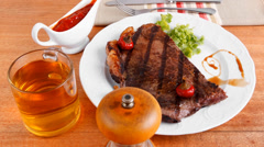 Rural design new york meat style beef steak fillet on white plate Stock Footage