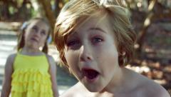 An 8yr Old Boy And A 5yr Old Girl Make Silly Faces Stock Footage