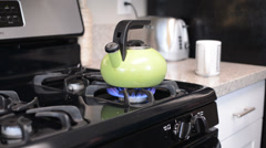 Stock Video Footage of Person pours hot watter, focus on kettle