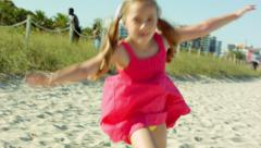 Little Girl Practices Cartwheels On The Beach Stock Footage