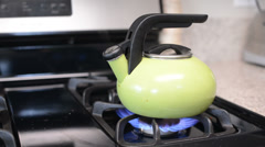 Stock Video Footage of Tea kettle boils on gas stove