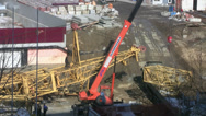 Stock Video Footage of Unloading parts of the crane on construction site