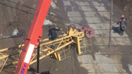 Stock Video Footage of Installation of a crane at a construction site. Advancing cable