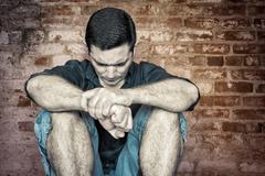 Grunge image of a depressed and lonely young man Stock Photos