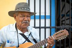 musician playing traditional music in havana - stock photo