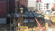 Stock Video Footage of Time lapse day at a construction site. unloading parts of the crane