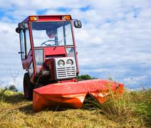 Agrimotor on meadow Stock Photos