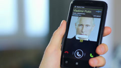 Official receiving call from Russian President Putin, close-up Stock Footage