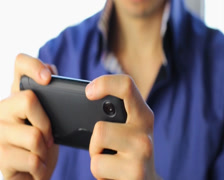 Man playing sensor games on touch phone, YES, losing, close-up, click for HD - stock footage