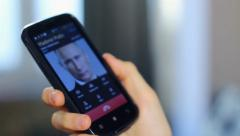 US government official receiving call from Putin, talks close-up, click for HD Stock Footage