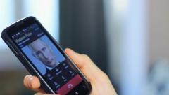 Official talking to Vladimir Putin, phone conversation, close-up, click for HD Stock Footage