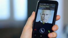 Official receiving call from Russian President Putin, close-up, click for HD Stock Footage
