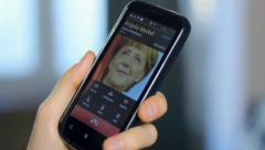 US official talking by phone to German Chancellor Angela Merkel, click for HD Stock Footage