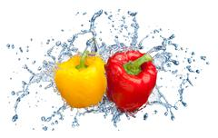 Pepper in spray of water. Stock Photos
