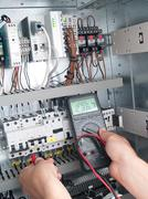 Engineer makes maintenance of power network automation Stock Photos