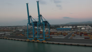 Stock Video Footage of passing shot of cranes at port