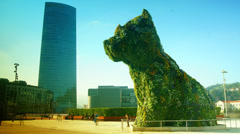 Bilbao Iberdrola Tower and Puppy sculpture in Bilbao, Spain Stock Footage
