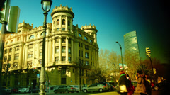 Scene from Bilbao city in the afternoon, pedestrians cross the street, Stock Footage