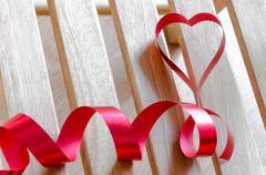 red satin ribbon heart shaped - stock photo