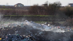 Burning trash, pollution, garbage dump, smoke, construction & demolition waste Stock Footage
