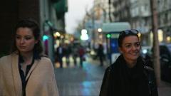 Three women walking along the street Stock Footage