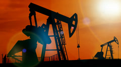 Pump jacks in the sunset Stock Footage