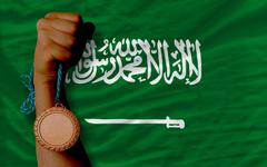 Bronze medal for sport and  national flag of  of saudi arabia Stock Photos