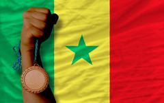 bronze medal for sport and  national flag of senegal - stock photo