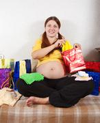 Pregnant woman with purchases Stock Photos