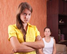 Mother and  daughter having quarrel - stock photo