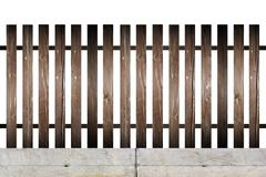 old wood fence model on concrete foundation - stock photo