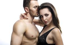 Sexy young couple kissing Stock Photos