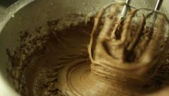 Using an electric mixer to beat cocoa powder and flour Stock Footage
