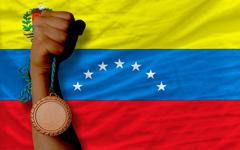 Stock Photo of bronze medal for sport and  national flag of venezuela