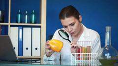 Biochemist examine fresh yellow pepper in laboratory Stock Footage