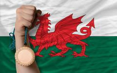 bronze medal for sport and  national flag of wales - stock photo